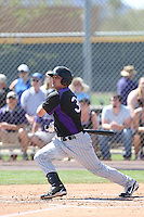Jordan Ribera #39 of the Colorado Rockies bats during a Minor League Spring Training Game against the San Francisco Giants at the Colorado Rockies Spring Training Complex on March 18, 2014 in Scottsdale, Arizona. (Larry Goren/Four Seam Images)