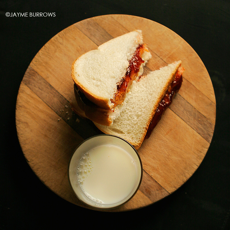 Peanut butter and jelly sandwich with cold milk.