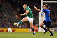 Ian Madigan of Ireland puts in a grubber kick. Rugby World Cup Pool D match between France and Ireland on October 11, 2015 at the Millennium Stadium in Cardiff, Wales. Photo by: Patrick Khachfe / Onside Images