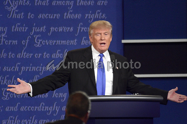 Businessman Donald J. Trump, the Republican Party nominee for President of the United States, makes a point as he appears with former US Secretary of State Hillary Clinton, the Democratic Party nominee for President of the US in the first of three presidential general election debates at Hofstra University in Hempstead, New York on Monday, September 26, 2016. Photo Credit: Ron Sachs/CNP/AdMedia