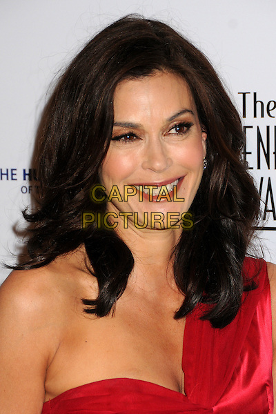 TERI HATCHER.24th Annual Genesis Awards - Arrivals held at the Beverly Hilton Hotel, Beverly Hills, California, USA, 20th March 2010..portrait headshot smiling make-up red one shoulder wrinkles mouth open .CAP/ADM/BP.©Byron Purvis/AdMedia/Capital Pictures.