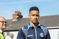 Paris Cowan-Hall of Wycombe Wanderers arrives at the ground under the watchful eye of a Security Steward ahead of the Sky Bet League 2 match between Grimsby Town and Wycombe Wanderers at Blundell Park, Cleethorpes, England on 4 March 2017. Photo by Andy Rowland / PRiME Media Images.