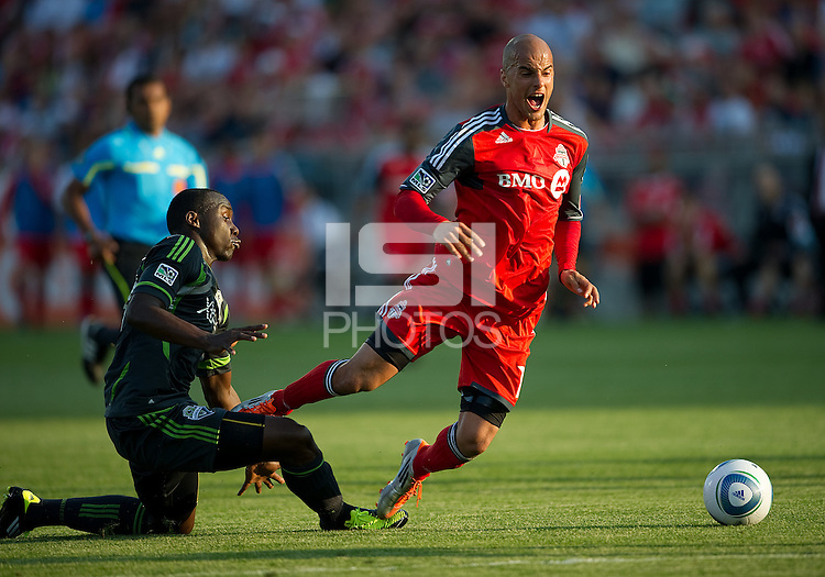 Seattle Sounders FC defender Jhon Kennedy Hurtado #34 and Toronto FC defender Mikael Yourassowsky #19 in action during an MLS game between the Seattle Sounders FC and the Toronto FC at BMO Field in Toronto on June 18, 2011.