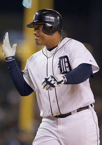 September 27, 2011:  Detroit Tigers first baseman Miguel Cabrera (#24) touches home plate after hitting his 30th home run in the sixth inning during MLB game action between the Cleveland Indians and the Detroit Tigers at Comerica Park in Detroit, Michigan.  The Tigers defeated the Indians 9-6.