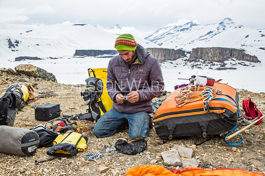 Lucho Birkner at base camp preparing his bolting gear, Valle des los Condores.