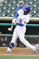 Arismendy Alcantara #5 of the Iowa Cubs swings against the Omaha Storm Chasers at Principal Park on May 1, 2014 in Des Moines, Iowa. The Cubs  beat Storm Chasers 1-0.   (Dennis Hubbard/Four Seam Images)