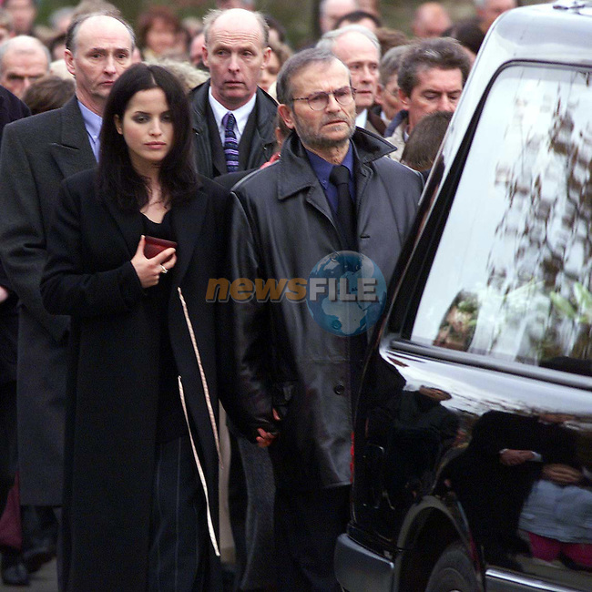 Andrea Corrwalking with her father Gerry behind her mothers coffin on the way to church. Gean Corr passed away after an Asthma attack while in England on Wednesday.Pic Newswfile.By Line Please..Camera:   DCS620C.Serial #: K620C-01943.Width:    1728.Height:   1152.Date:  27/11/99.Time:   13:57:11.DCS6XX Image.FW Ver:   1.9.6.TIFF Image.Look:   Product.Counter:    [631].Shutter:  1/250.Aperture:  f4.0.ISO Speed:  640.Max Aperture:  f2.8.Min Aperture:  f32.Focal Length:  200.Exposure Mode:  Manual (M).Meter Mode:  Color Matrix.Drive Mode:  Continuous High (CH).Focus Mode:  Continuous (AF-C).Focus Point:  Center.Flash Mode:  Normal Sync.Compensation:  +0.0.Flash Compensation:  +0.0.Self Timer Time:  10s.White balance: Auto (Daylight).Time: 13:57:11.220.