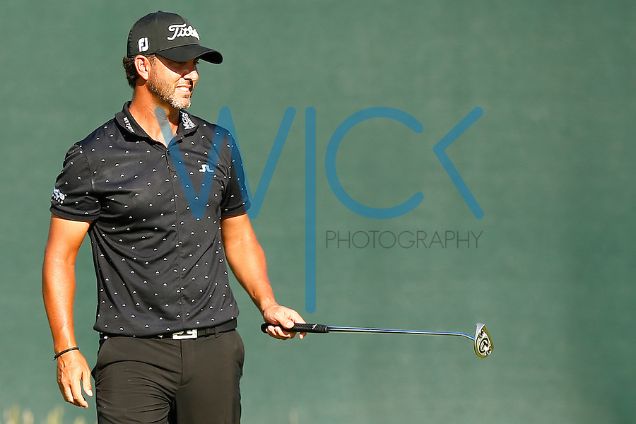 Scott Piercy putts on the 2nd hole during the 2016 U.S. Open in Oakmont, Pennsylvania on June 17, 2016. (Photo by Jared Wickerham / DKPS)
