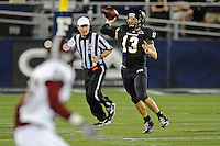 25 October 2011:  FIU quarterback Wesley Carroll (13) passes while rolling out in the first quarter as the FIU Golden Panthers defeated the Troy University Trojans, 23-20 in overtime, at FIU Stadium in Miami, Florida.