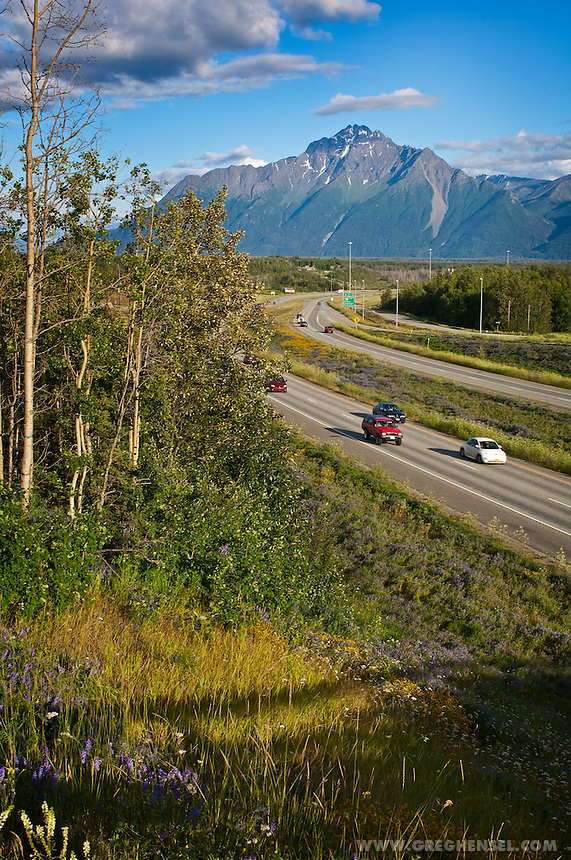 Traffic commuting on the Parks Highway passes by Pioneer Peak near Palmer. Summer in Southcentral ALaska.
