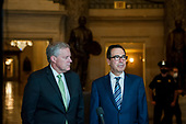 White House Chief of Staff Mark Meadows, left, and United States Secretary of the Treasury Steven T. Mnuchin, talk to reporters following a meeting with Speaker of the US House of Representatives Nancy Pelosi (Democrat of California), and US Senate Minority Leader Chuck Schumer (Democrat of New York) regarding the COVID-19 economic stimulus package deal which lasted over three hours at the US Capitol in Washington, DC., Thursday, August 6, 2020. Credit: Rod Lamkey / CNP