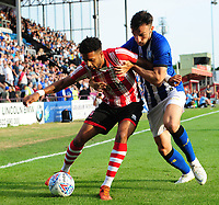 Lincoln City's Bruno Andrade shields the ball from Sheffield Wednesday's Morgan Fox<br /> <br /> Photographer Chris Vaughan/CameraSport<br /> <br /> Football Pre-Season Friendly - Lincoln City v Sheffield Wednesday - Friday 13th July 2018 - Sincil Bank - Lincoln<br /> <br /> World Copyright &copy; 2018 CameraSport. All rights reserved. 43 Linden Ave. Countesthorpe. Leicester. England. LE8 5PG - Tel: +44 (0) 116 277 4147 - admin@camerasport.com - www.camerasport.com