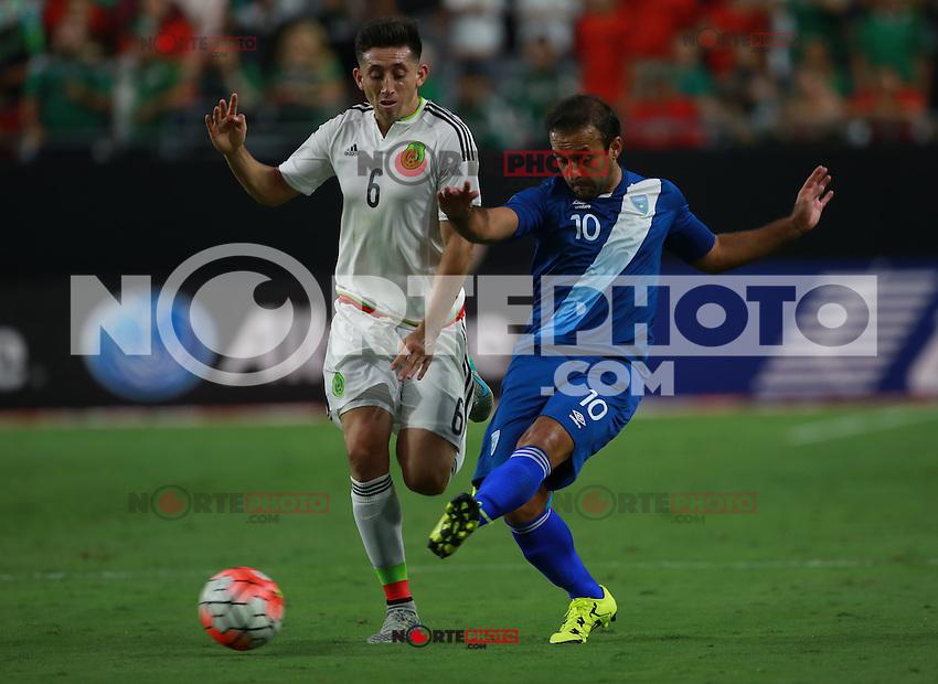 Hector Herrera de Mexico y Jose contreras  de Guatemala  ,durante partido entre las selecciones de Mexico y Guatemala  de la Copa Oro CONCACAF 2015. Estadio de la Universidad de Arizona.<br /> Phoenix Arizona a 12 de Julio 2015.
