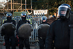 Riot police coming into Dale Farm site where activists and travellers trying to stop the eviction that will leave 82 travellers families homeless. October 2011 Basildon UK