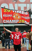 """Pictured: A man holding a """"20 Times Champions"""" flag outside the ground before kick off. Sunday 12 May 2013<br /> Re: Barclay's Premier League, Manchester City FC v Swansea City FC at the Old Trafford Stadium, Manchester."""