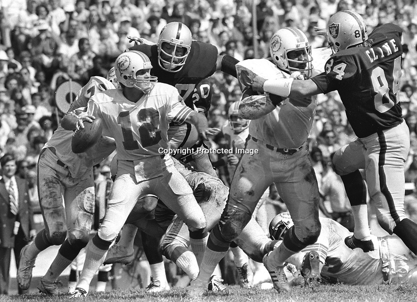 Miami Dolphins QB Bob Griese , Bubba Smith and Tony Cline for Raiders (1973 photo/Ron Riesterer)