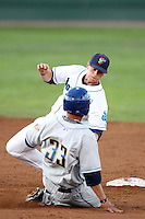 Everett Aquasox infielder Marcus Littlewood #9 tags out Tri-City Dust  Devils Leonardo Reyes #33 at second base at Everett Memorial Stadium on August 12, 2011 in Everett,Washington. Tri-City defeated Everett 8-5.(Larry Goren/Four Seam Images)