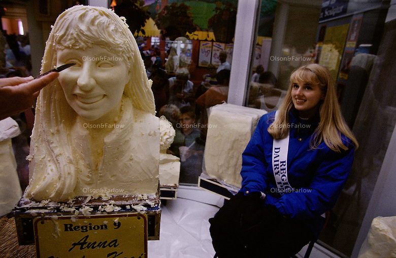 Each year, Minnesota's regional dairy princess has her likeness carved in an 85-pound block of butter. Anna Vander Kooi, sits patiently while her butter bust is being carved. Anna has won countless Nobles County Fair ribbons in bread, clothing and dairy food categories.