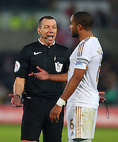 Referee Kevin Friend gestures to Ashley Williams of Swansea City during the Barclays Premier League match between Swansea City and Arsenal played at The Liberty Stadium, Swansea on October 31st 2015