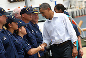 United States President Barack Obama and First Lady Michelle shake hands with members of the US Coast Guard at a Coast Guard base in Panama City, Florida USA on Saturday, 14 August  2010.  The First Family is visiting the area to help promote tourism and check up on clean up efforts from the aftermath of the Deepwater Horizon Oil spill.  .Credit: Dan Anderson / Pool via CNP