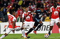BOGOTA - COLOMBIA - 01 - 03 - 2018: William Tesillo (Izq.), William Tesillo (2 Izq.) y Javier Lopez (Der.) jugadores de Independiente Santa Fe disputan el balón con Eduar Preciado (Cent.), jugador de Emelec (ECU), durante partido entre Independiente Santa Fe (COL) y Emelec (ECU), de la fase de grupos, grupo 4, fecha 1 de la Copa Conmebol Libertadores 2018, jugado en el estadio Nemesio Camacho El Campin de la ciudad de Bogota. / William Tesillo (L) and William Tesillo (2 L) and Javier Lopez (R) players of Independiente Santa Fe vie for the ball with Eduar Preciado (C), player of Emelec (ECU), during a match between Independiente Santa Fe (COL) and Emelec (ECU), of the group stage, group 4, 1st date for the Conmebol Copa Libertadores 2018 at the Nemesio Camacho El Campin Stadium in Bogota city. Photo: VizzorImage  / Luis Ramirez / Staff.