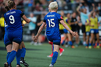 Seattle, WA - Saturday, July 1, 2017:  Merritt Mathias and Megan Rapinoe during a regular season National Women's Soccer League (NWSL) match between the Seattle Reign FC and the Portland Thorns FC at Memorial Stadium.