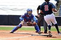 Daytona Cubs catcher Chadd Krist (16) looks to tag out Cito Culver (2) attempting to score during a game against the Tampa Yankees  on April 13, 2014 at George M. Steinbrenner Field in Tampa, Florida.  Tampa defeated Daytona 7-3.  (Mike Janes/Four Seam Images)