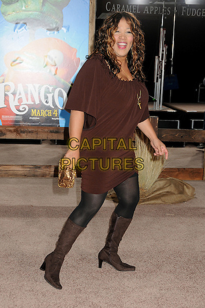 "KYM WHITLEY.The L.A. Premiere of ""Rango"" held at The Regency Village Theatre in Westwood, California, USA, .February 14th 2011.full length brown dress boots black tights .CAP/ADM/BP.©Byron Purvis/AdMedia/Capital Pictures."
