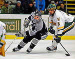 7 February 2009: Providence College Friars' center John Cavanagh (16), a Junior from Warwick, R.I., moves in for a play on net as University of Vermont Catamount defenseman Kyle Medvec (6), a Sophomore from Burnsville, MN, prepares for a possible rebound during the second game of a weekend series at Gutterson Fieldhouse in Burlington, Vermont. The Catamounts swept the 2-game series notching 4-1 wins in both games. Mandatory Photo Credit: Ed Wolfstein Photo