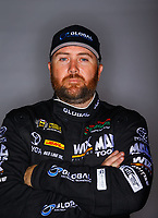Feb 7, 2018; Pomona, CA, USA; NHRA funny car driver Shawn Langdon poses for a portrait during media day at Auto Club Raceway at Pomona. Mandatory Credit: Mark J. Rebilas-USA TODAY Sports