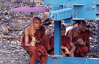 This group of Buddhist Monks watching a local soccer game at the outskirts of Yangon, the Capital of Burma, Myanmar