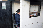 Bacup Borough 4 Holker Old Boys 1, 25/04/2016. Brain Boys West View Stadium, NorthWest Counties League Division One. The turnstile operator waiting for spectators to arrive at the Brain Boys West View Stadium before Bacup Borough play Holker Old Boys in a NorthWest Counties League division one fixture. Formed as Bacup in 1879, the club moved into their current home in 1889 and have been known as Bacup Borough since the 1920s, apart from a brief recent spell when they added the name Rossendale to their name. With both teams challenging for play-off places, Bacup Borough won this fixture by 4-1, watched by a crowd of 50. Photo by Colin McPherson.
