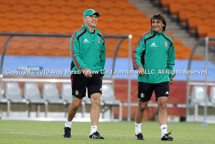 10 JUN 2010: Head coach Javier Aguirre (left) with assistant coach Juan Iribarren (right). The Mexico National Team held a light practice at Soccer City Stadium in Johannesburg, South Africa the day before playing South Africa in the opening match of the 2010 FIFA World Cup.