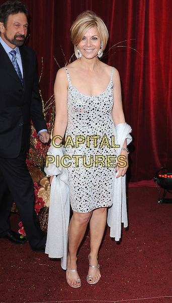 GLYNIS BARBER.Arrivals at the British Soap Awards 2010, London Television Centre, London, England..May 8th, 2010. full length silver sequined sequin wrap dress sandals shiny sparkly embellished shawl pashmina .CAP/BEL.©Tom Belcher/Capital Pictures.