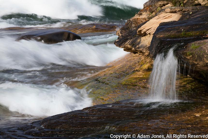 Waves and small waterfall at Miners Beach, Lake Superior, Pictured Rocks National Lakeshore, Michigan, Upper Peninsula