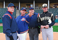 April 7, 2009: Greenville Drive manager Kevin Boles, second from left, points out the ground rules to the umpires and Wofford head coach Todd Interdonato, right, before a game against the Class A Greenville Drive on Tuesday, April 7, 2009, at Fluor Field in Greenville. Photo by:  Tom Priddy/Four Seam Images