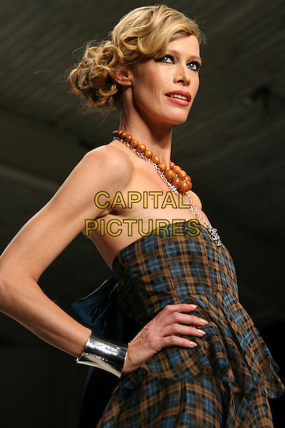 LESA AMOORE.Mercedes-Benz Fall 2006 L.A. Fashion Week - Kelly Nishimoto Fall 2006 held at Smashbox Studios, Culver City, California, USA..March 22nd, 2006.Photo: Zach Lipp/AdMedia/Capital Pictures.Ref: ZL/ADM.catwalk runway half length blue brown strapless plaid bracelet bangle necklace beaded.www.capitalpictures.com.sales@capitalpictures.com.© Capital Pictures.