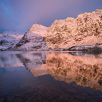 Vibrant winter light shines on mountains above lake Ågvatnet, Å I Lofoten, Moskenesøy, Lofoten Islands, Norway