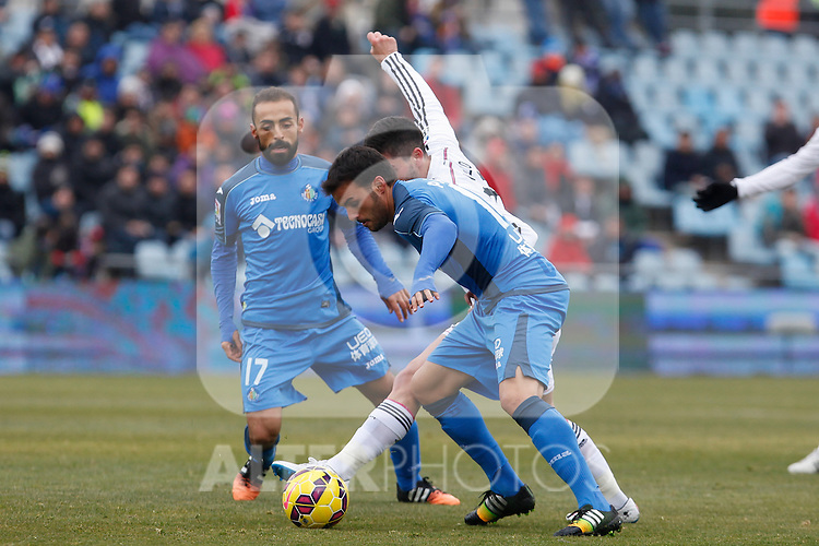 Getafe´s Pedro Leon and Diego Castro and Real Madrid´s Isco during La Liga match at Coliseum Alfonso Perez stadium  in Getafe, Spain. January 18, 2015. (ALTERPHOTOS/Victor Blanco)
