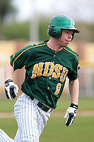 North Dakota State Bison outfielder Tim Colwell #9 during a game against the Pennsylvania Quakers at Henley Field on March 11, 2012 in Lakeland, Florida.  North Dakota State defeated Pennsylvania 15-3.  (Mike Janes/Four Seam Images)