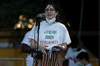 """Representative of Italiani Senza Cittadinanza. <br /> <br /> Rome, 05/07/2020. Today, thousands of people gathered in Piazza San Giovanni to attend the """"Stati Popolari"""". The rally, organised by Aboubakar Soumahoro (1.) - Trade Union Coordinator of the Unione Sindacale di Base USB, was meant to be a popular answer by the """"Invisibles"""" to the """"Stati Generali dell'Economia"""" (States General of the Economy, 2.) of the Italian Prime Minister Giuseppe Conte, a 10-day-long meeting held in June at Villa Doria Pamphili (Villa Doria Pamphilj, 2.) where Italian and EU leaders / members of Governments, bankers, investors, advisors, met to discuss the economic recovery from the Covid-19 / Coronavirus crisis. From the organisers Facebook event page: «The Popular States will be our agora, where different realities will bring their pains and their proposals. A human square to make all the invisible visible and to give voice to all the unheard, our only symbol. The Popular States will be the communion of our needs and our struggles […]» (3.). At the end of the demo Soumahoro, who mainly deals with protection of """"Braccianti"""" (agricultural workers) rights, fights against """"caporalato"""" (illegal hiring) and the exploitation along the agricultural supply chain, gave a speech (4.) addressing the requests to the Government: - National plan for the work emergency; - Public housing program; - integral reform of the food supply chain; - radical transformation of migration policies (including, the """"right to return"""" for Italian migrants); - abolish the """"Security decrees"""" and cancel Bossi-Fini law; - reform the reception; - ecological transition strategy; - proactive interventions against discrimination and for equality.<br /> <br /> Footnotes & Links:<br /> 1. (Wikipedia.org) http://bit.do/fF4rH<br /> 2. 16.06.20 Aboubakar Soumahoro: Hunger/Thirst Strike And Meeting With Italian Prime Minister Conte http://bit.do/fGrbH<br /> 3. http://bit.do/fGrbD<br /> 4. Aboubakar Soumahoro Speech: http://bit.do"""