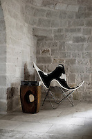 This original bat chair by Jorge Ferrain-Hardoy, 1938 has been covered in cow-hide