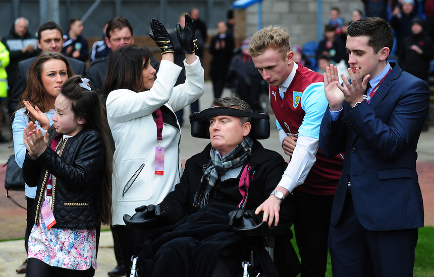 Former Burnley and Middlesbroough defender Gary Parkinson who has been left with Locked-In Syndrome since suffering a stroke in 2010 surrounded by his family on the pitch at half time<br /> <br /> Photo by Chris Vaughan/CameraSport<br /> <br /> Football - The Football League Sky Bet Championship - Burnley v Middlesbrough - Saturday 12th April 2014 - Turf Moor - Burnley<br /> <br /> &copy; CameraSport - 43 Linden Ave. Countesthorpe. Leicester. England. LE8 5PG - Tel: +44 (0) 116 277 4147 - admin@camerasport.com - www.camerasport.com