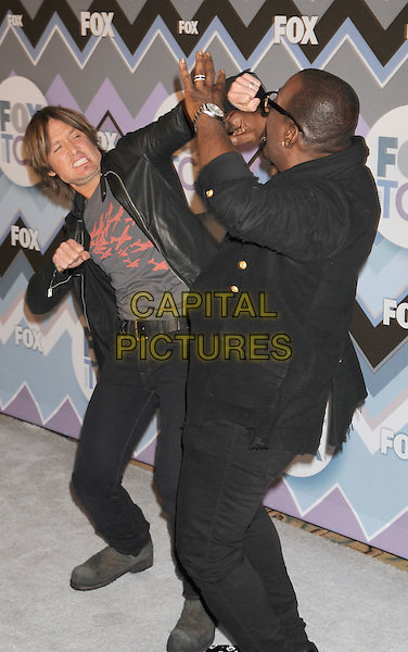 Keith Urban, Randy Jackson.arriving at the 2013 TCA Winter Press Tour - FOX All-Star Party at The Langham Huntington Hotel and Spa in Pasadena, California, USA, .January 8th, 2013.   .full length black leather jacket grey gray t-shirt hand  funny fighting punching fist staged posed fight  black shirt glasses  flower print shoes .CAP/ROT/TM.©Tony Michaels/Roth Stock/Capital Pictures