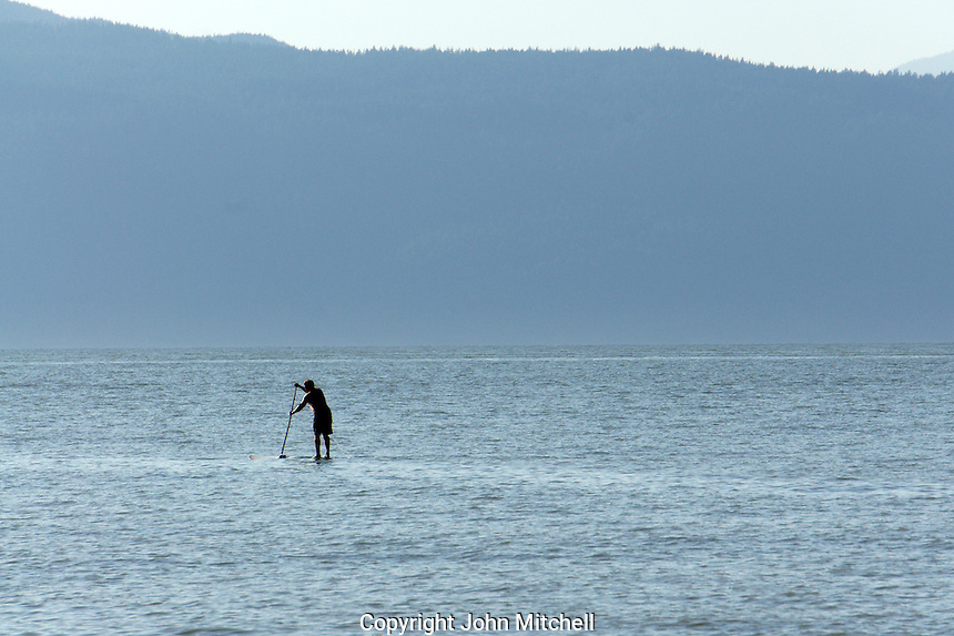 Man stand up paddle boarding, Vancouver, British Columbia, Canada