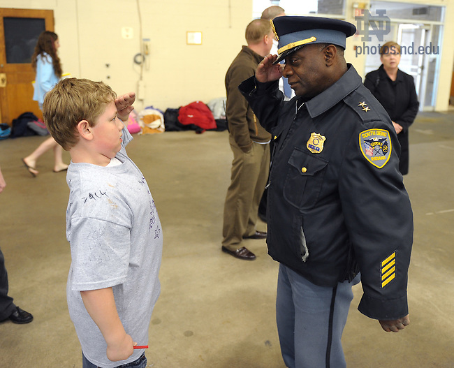"""May 5, 2011; A student salutes South Bend Police Chief Darryl Boykins at the Robinson Center's 2011 """"Take Ten"""" event at Stepan Center...Photo by Matt Cashore/University of Notre Dame"""