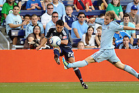 Shea Salinas (22) Vancouver Whitecaps midfielder crosses the ball ahead of Sporting KC defender Seth Sinovic... Sporting KC defeated Vancouver Whitecaps 2-1 at LIVESTRONG Sporting Park, Kansas City, Kansas.