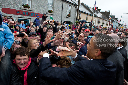 President Barack Obama greets people on Main Street in Moneygall, Ireland, May 23, 2011. .Mandatory Credit: Pete Souza - White House via CNP