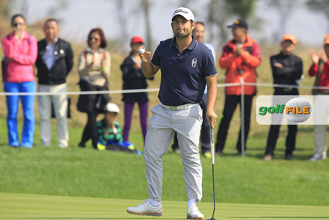 Alexander Levy (FRA) sinks his putt on the 5th green during Sunday's Final Round of the 2014 BMW Masters held at Lake Malaren, Shanghai, China. 2nd November 2014.<br /> Picture: Eoin Clarke www.golffile.ie
