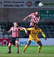 Lincoln City's Michael Bostwick clears over Northampton Town's Aaron Pierre<br /> <br /> Photographer Andrew Vaughan/CameraSport<br /> <br /> Emirates FA Cup First Round - Lincoln City v Northampton Town - Saturday 10th November 2018 - Sincil Bank - Lincoln<br />  <br /> World Copyright &copy; 2018 CameraSport. All rights reserved. 43 Linden Ave. Countesthorpe. Leicester. England. LE8 5PG - Tel: +44 (0) 116 277 4147 - admin@camerasport.com - www.camerasport.com